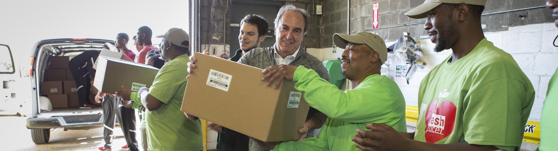 Volunteers unload donations.