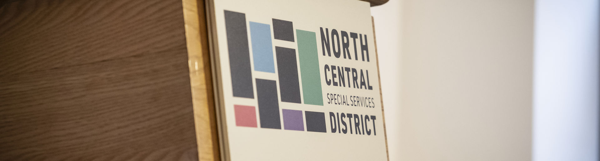 The North Central Special Services District signage on the front of a podium.