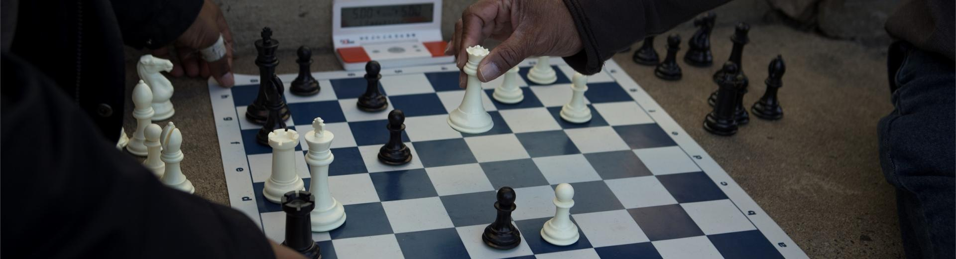 closeup of people playing chess